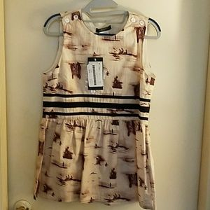 Sleeveless cotton top with gathered waist